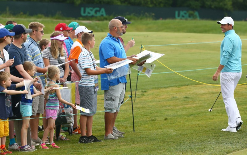 Jun 13 2017 Erin WI USA Fans try to get Rory Mc Ilroy to sign autographs as he walks to the practice range during a practice round of