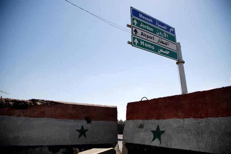 Final batch of Syrian rebels leave central Homs district