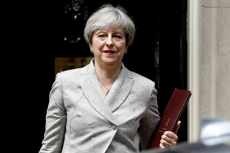 Talks on propping up UK PM May's Conservatives are 'very positive'