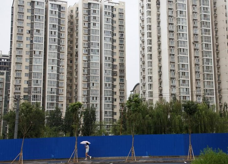 China to post solid, steady first-quarter growth on building boom, but debt risks loom