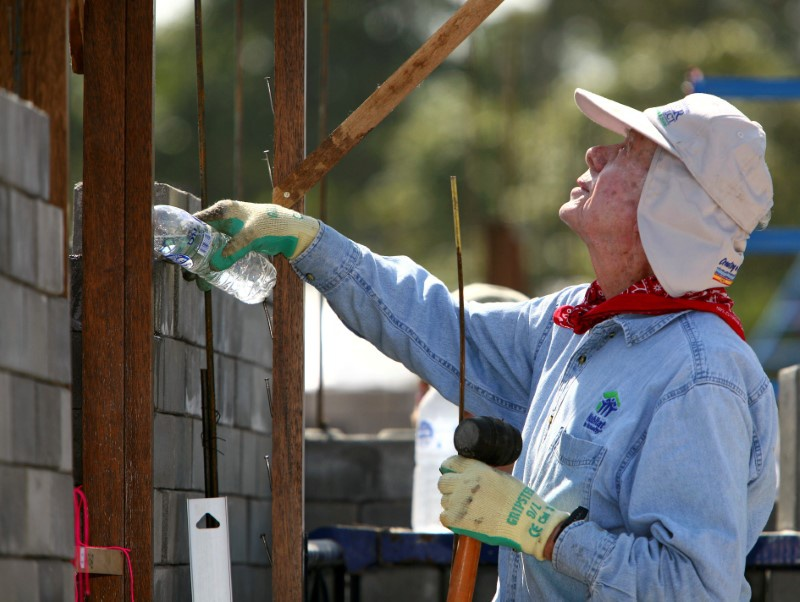 President Jimmy Carter takes part in building efforts during the
