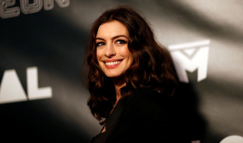 Cast member Anne Hathaway poses at the premiere of the movie