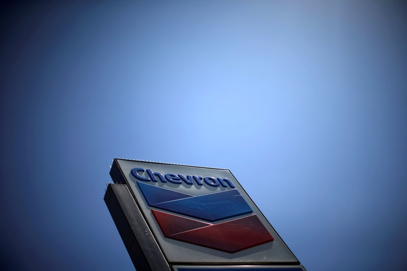 Chevron swings to profit on cost cuts, oil price