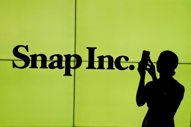 Snap's share price sinks, trades just above IPO price