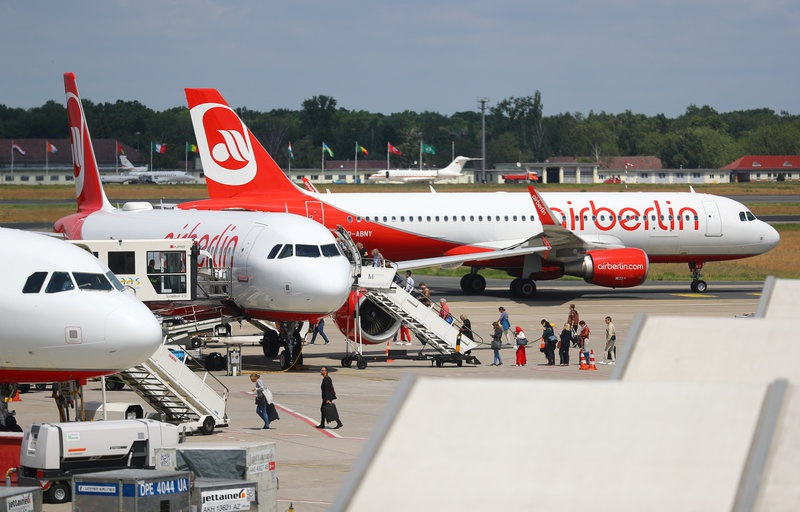 Passengers board a German carrier Air Berlin aircraft at Tegel airport in Berlin Germany