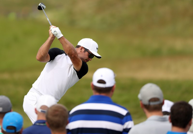 Patrick Reed sets early clubhouse target at rain-softened Erin Hills