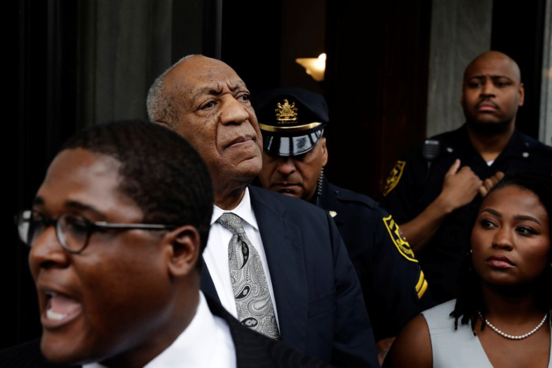 Actor and comedian Bill Cosby stands as his publicist Andrew Wyatt addresses the media after a judge declared a mistrial in Cosby&#39