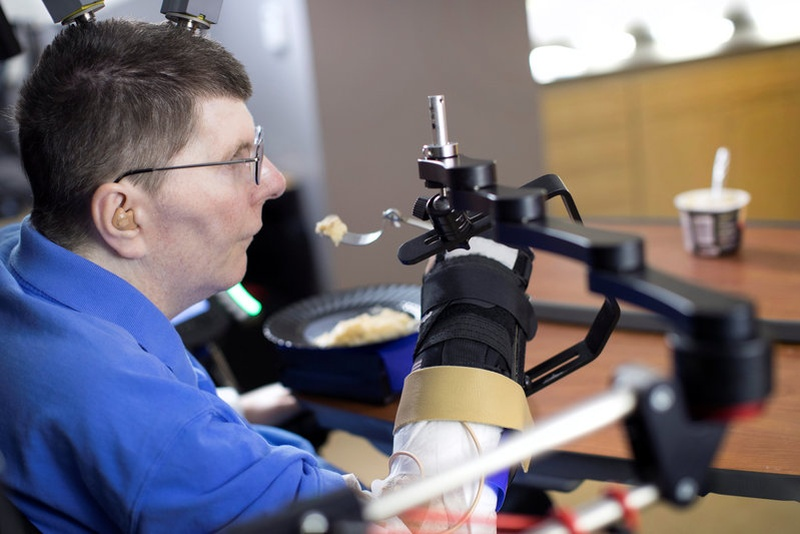 Man paralysed in accident can lift objects with thought-control technology