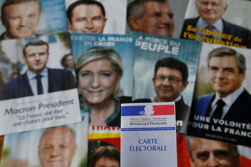 Gloves off in French election as Le Pen aide calls Macron 'arrogant'