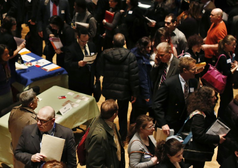 People wait in line to meet a job recruiter at the UJA-Federation Connect to Care job fair in New York