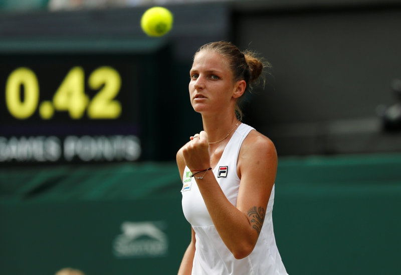 Czech Republic's Karolina Pliskova celebrates winning the first set during her second