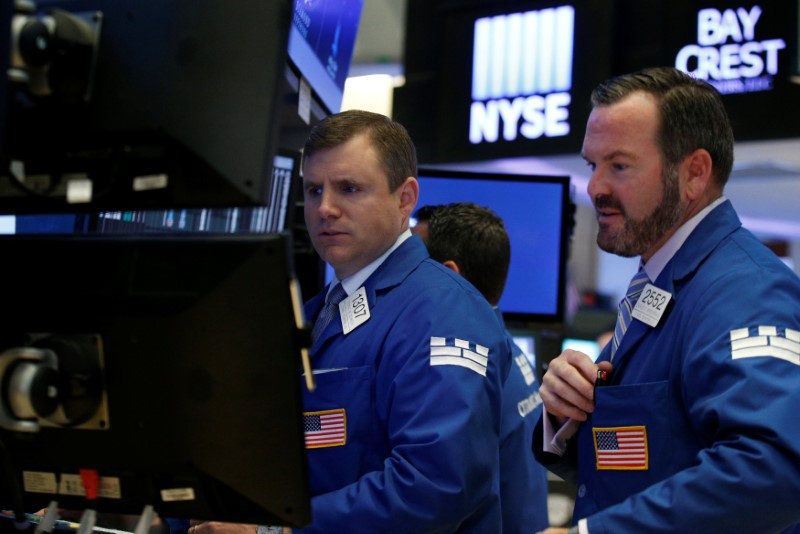 Wall Street reels under North Korea tensions, tepid retail earnings