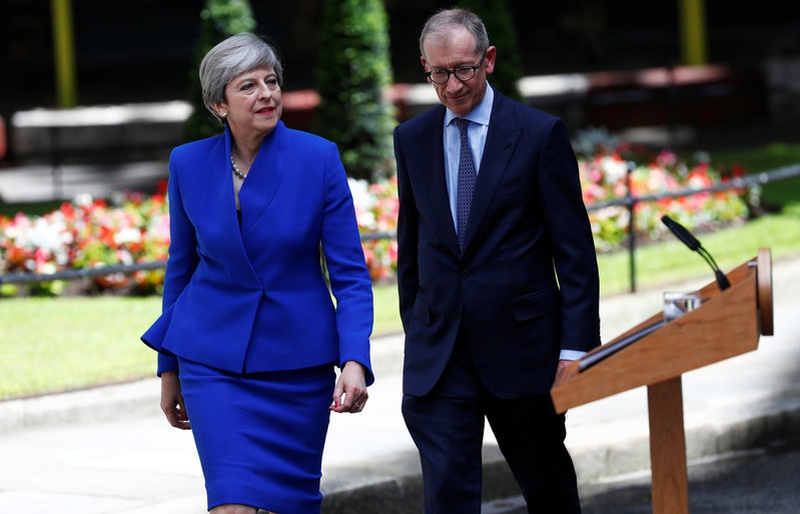 Britain, EU in suspense as May tries to strike power deal