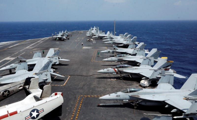 F18 fighter jets are parked on the deck of aircraft carrier USS Carl Vinson during a routine exercise in South China