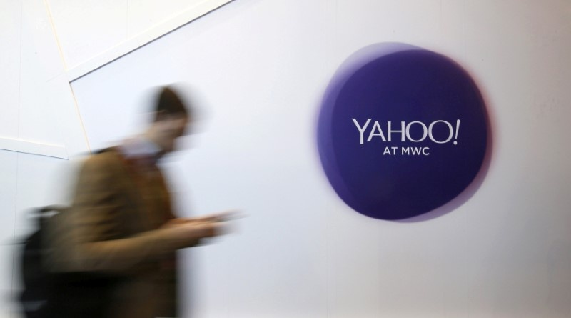 A man walks past a Yahoo logo during the Mobile World Congress in Barcelona Spain