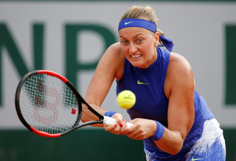 Kvitova wins opening match on grass in Birmingham