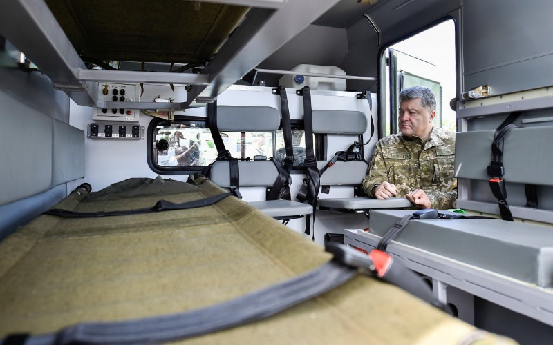 Ukrainian President Petro Poroshenko inspects a vehicle at a military mobile hospital during his visit to Donetsk region Ukraine