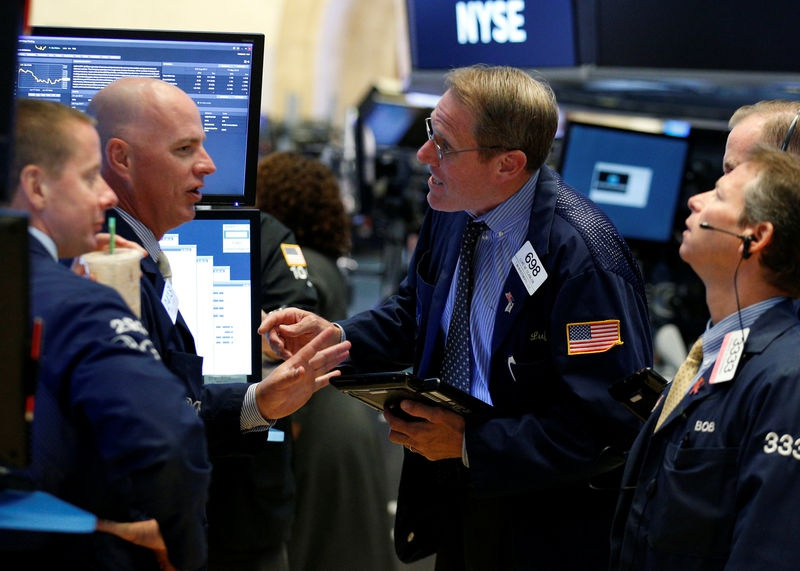 Wall St opens at record on strong earnings