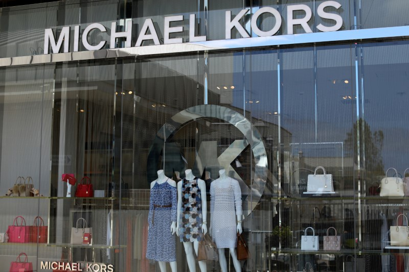 Michael Kors lifts revenue forecast, shares soar