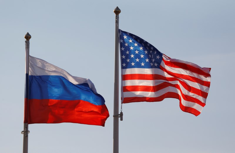 National flags of Russia and the U.S. fly at Vnukovo International Airport in Moscow Russia