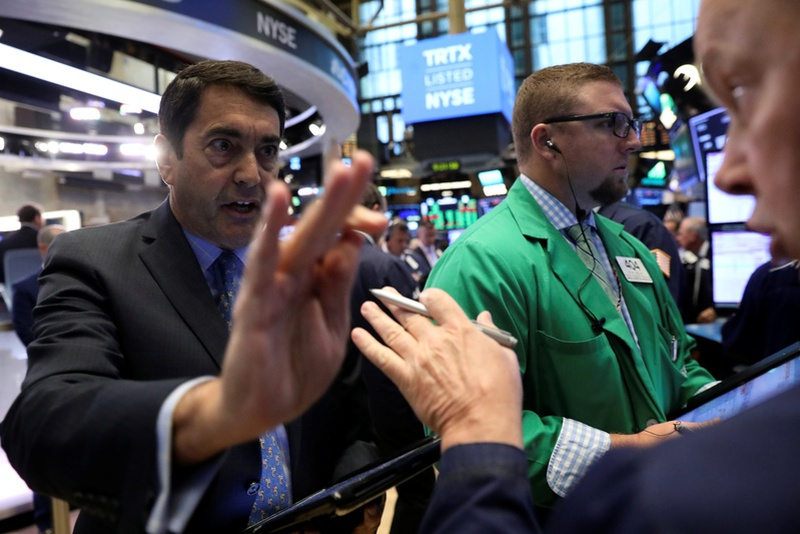 Wall St opens higher, Dow rises to record high