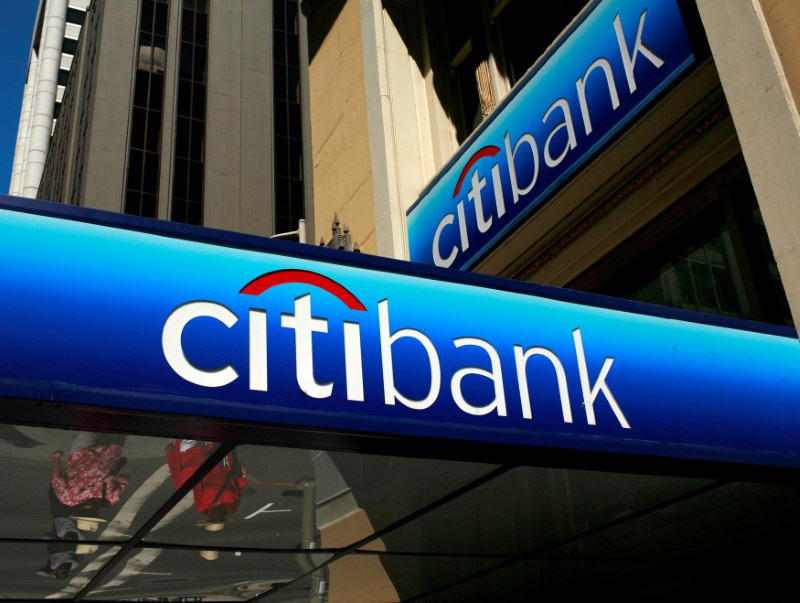 Citi hires ubs banker as china head of corporate investment banking file photo file photo people walk beneath a citibank branch logo in the altavistaventures Choice Image