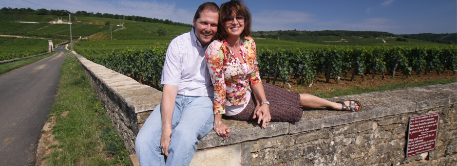Steve and Gloria alongside vineyard