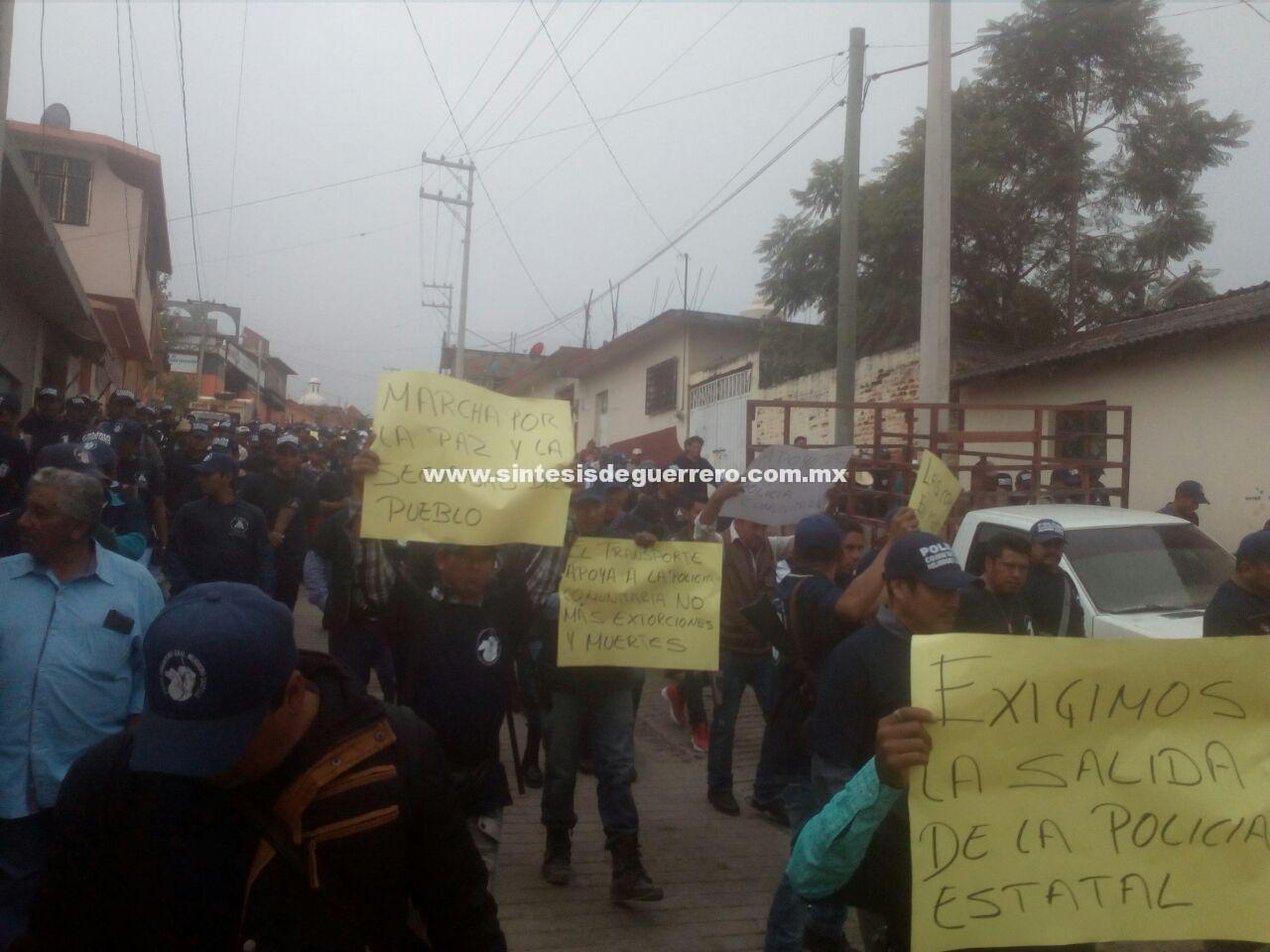 Marchan en Tlacotepec; exigen liberación de comunitarios de Mezcala y retiro de la Policía Estatal