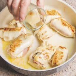Involtini di pollo con carciofi e prosciutto cotto