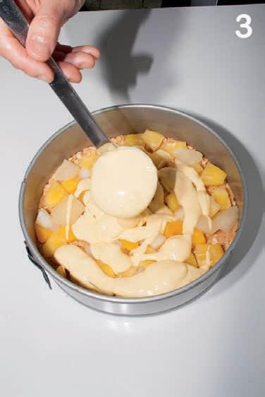 Cheesecake con ananas, pere e pesche sciroppate