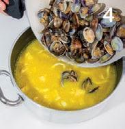 Zuppa di fagioli, ceci e curcuma con vongole e baccalà