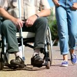 non emergency medical transportation person in wheelchair requiring assistance