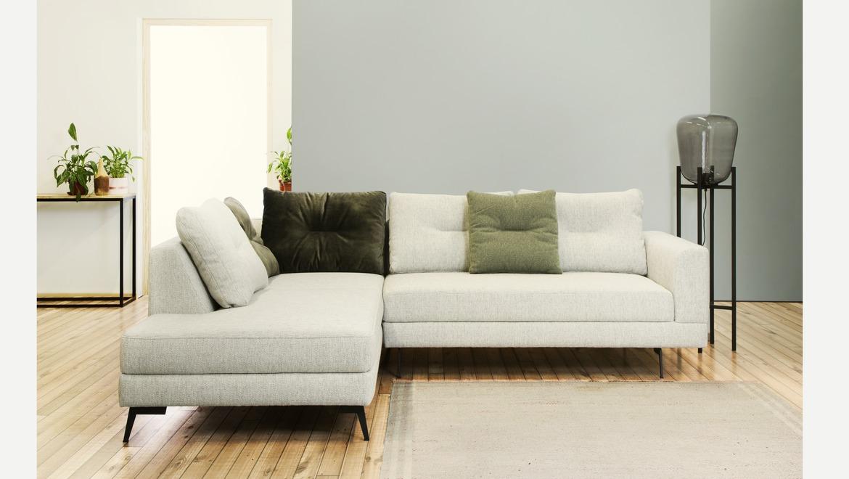 Moderne hoekzetel in stof op poten met verstelbare hoofdsteun kussens