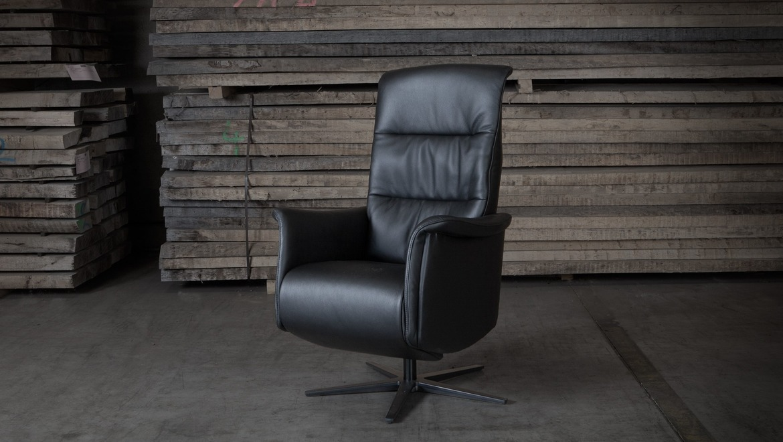 Elektrische relax in stof of leder op draaivoet in zwart