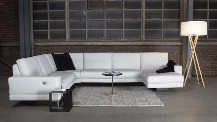 Moderne salon in stof of leder met relax en uitschuifbare rug in de hoogte
