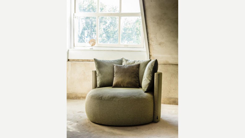 Ronde zetel in blauwe zachte fluweel stof met kussens