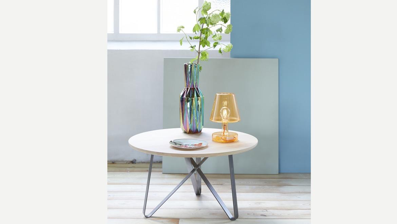 Ronde moderne salontafel met gekruiste poten in wit metaal