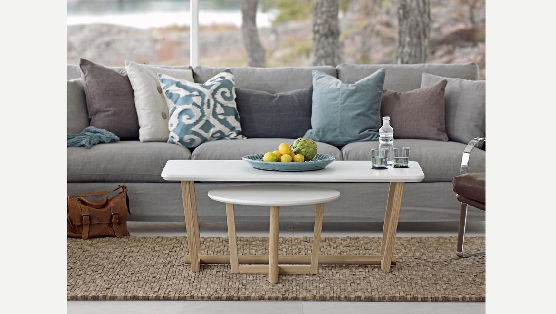 Witte rechthoekige salontafel op houten poten