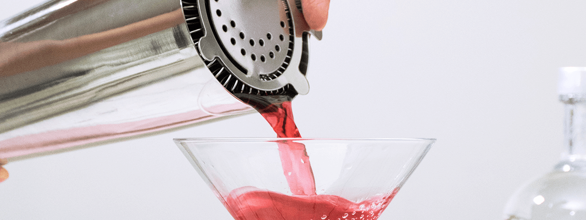 Image of drink being poured out of cocktail shaker