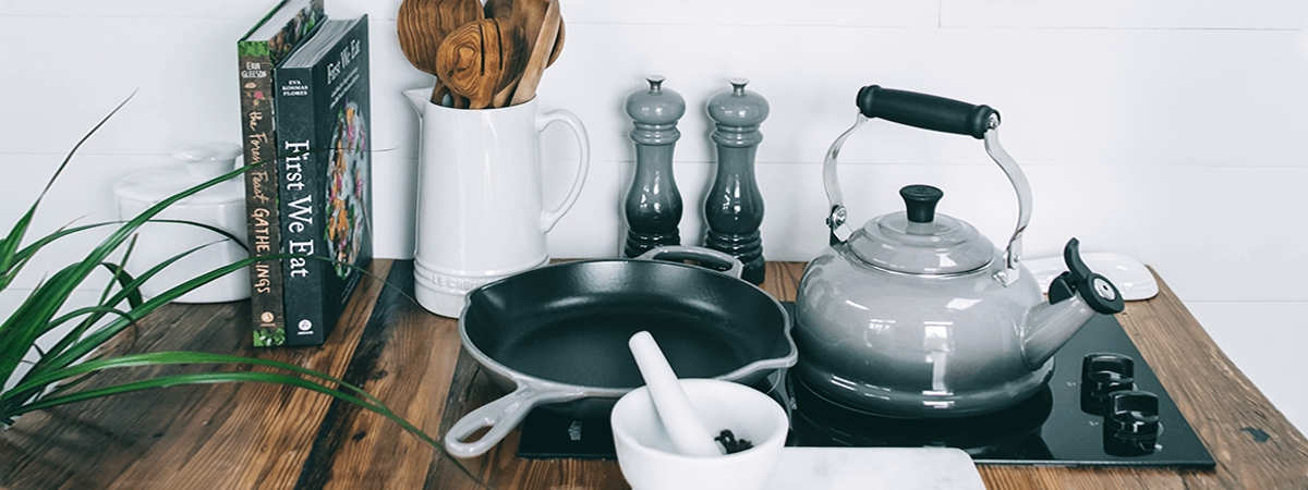 Image of countertop with pans, salt and pepper, and mortar and pestle