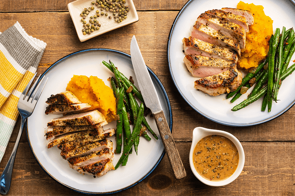 Seared Pork Chops with Almond Milk Green Peppercorn Gravy Butternut Squash Mash and Green Beans