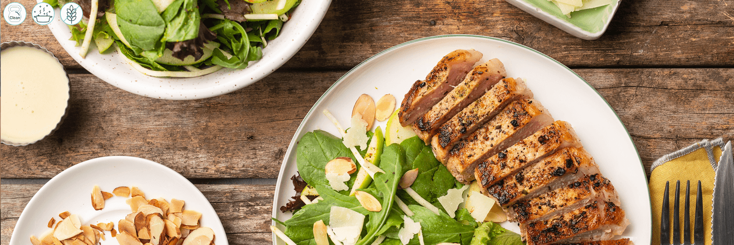 Lemon-Herbed Pork Chops with Apple and Celery Root Salad Toasted Almond Sprinkle
