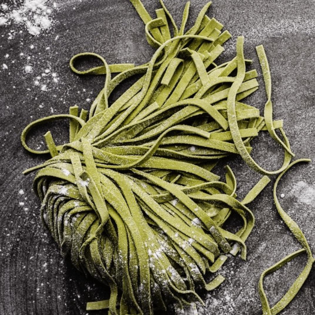 Fresh spinach linguine on a granite board