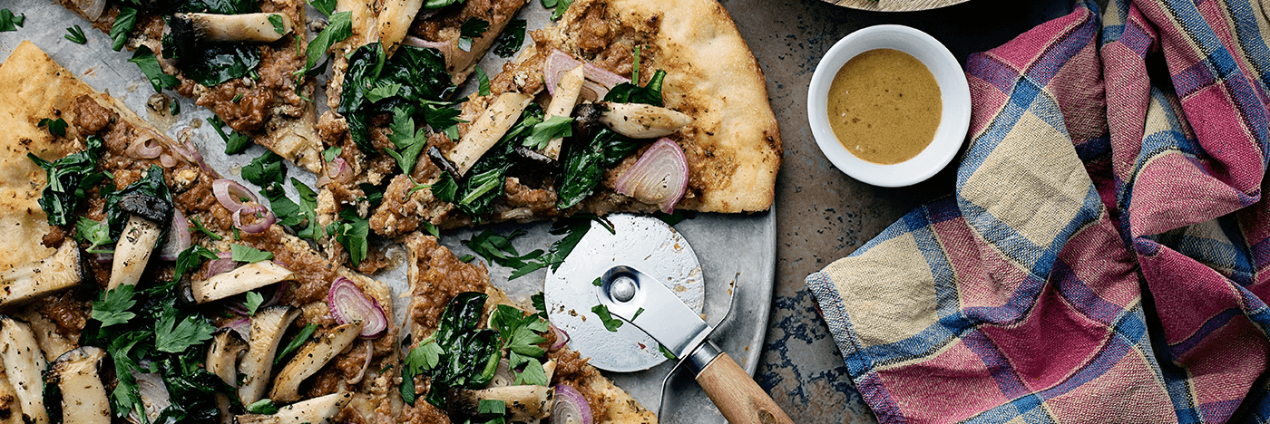 Sausage and Seared Mini King Oyster Mushroom Flatbread with Garlic Oil and Spinach Salad
