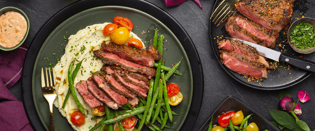 Steak Spice Striploin with Creamy Herb Mash and Choron Sauce Warm String Bean Salad recipe from Goodfood