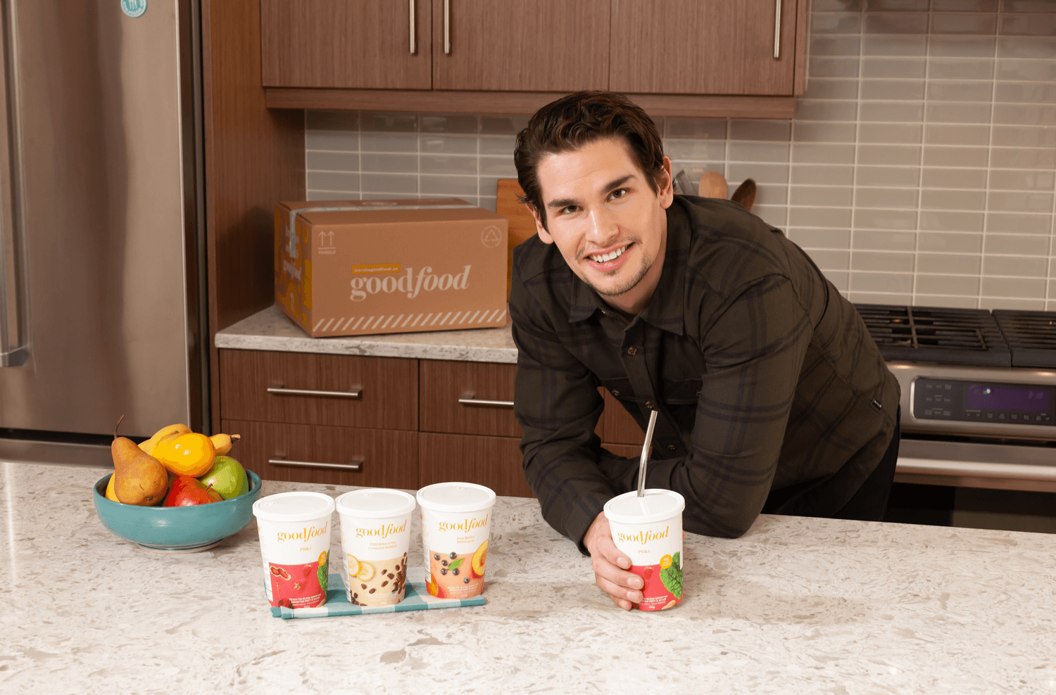 Sean Monahan in his kitchen with Goodfood smoothies