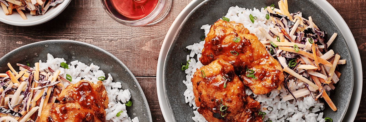 Crispy Chicken Thighs with Sesame Kohlrabi Slaw over Ginger Rice