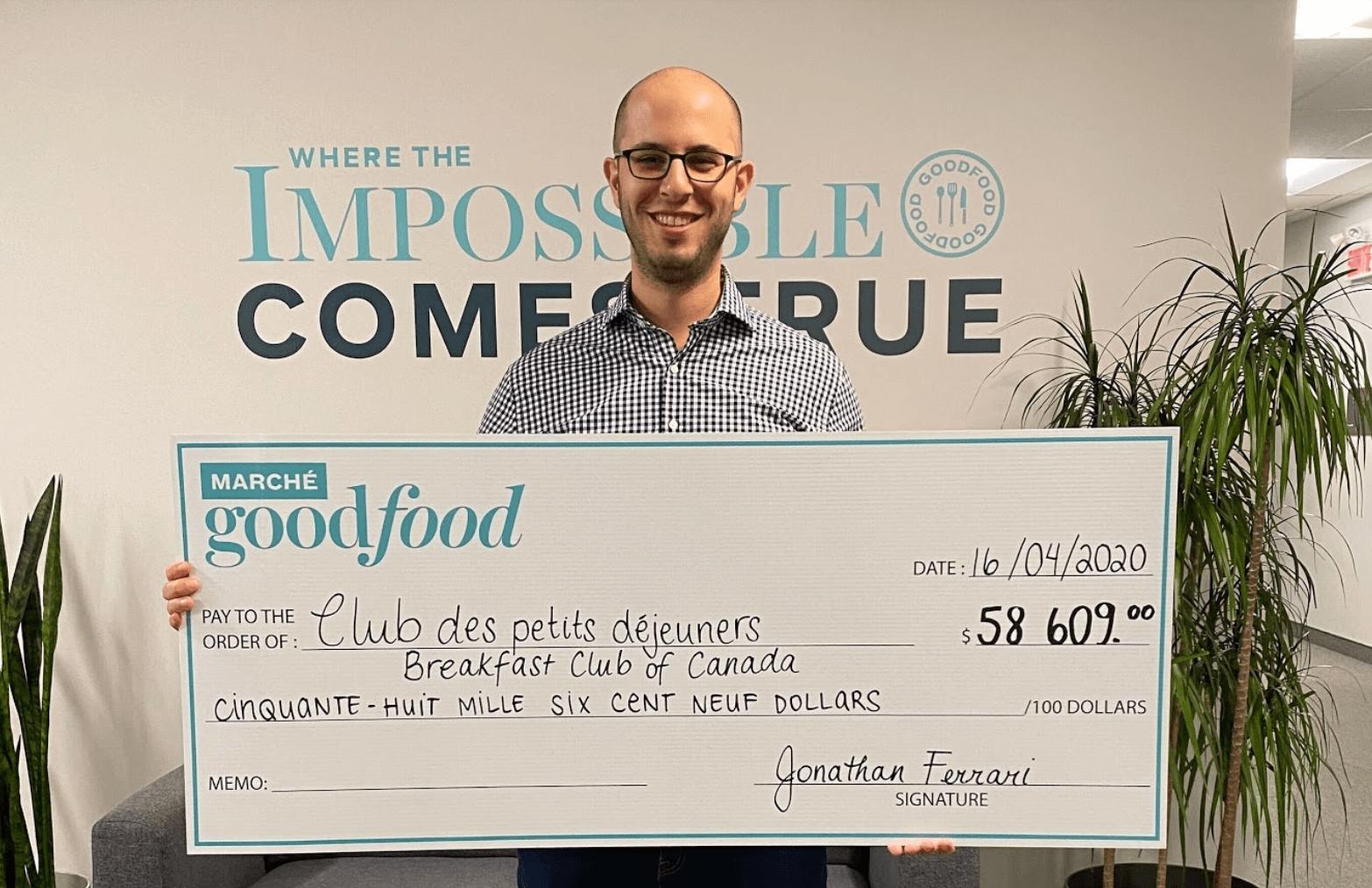 Jonathan Ferrari holding donation cheque