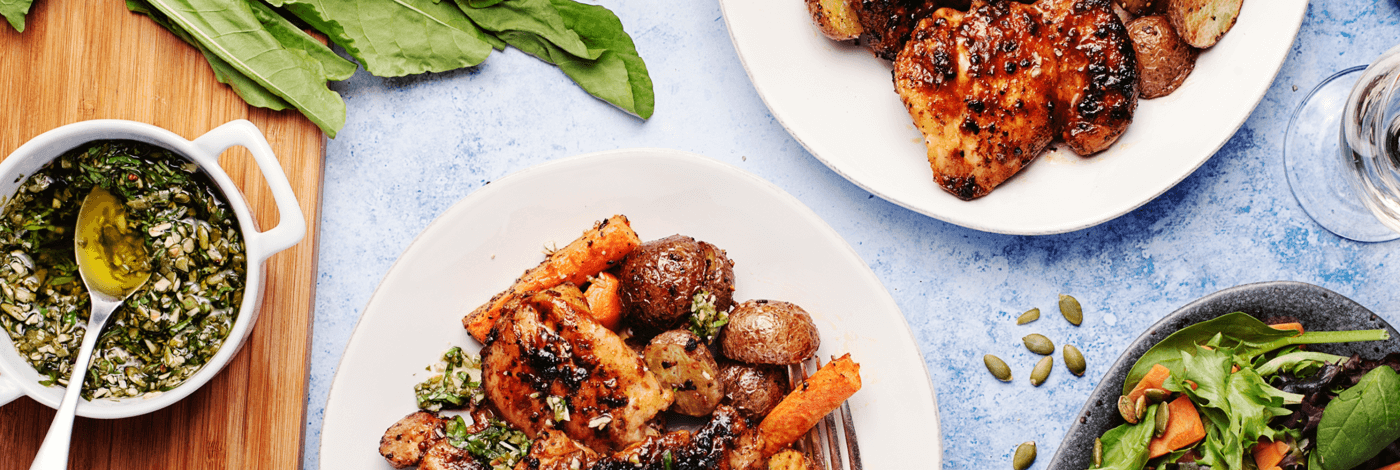BBQ Chicken with Sorrel-Pepita Pesto, Roasted Carrots, and Potatoes