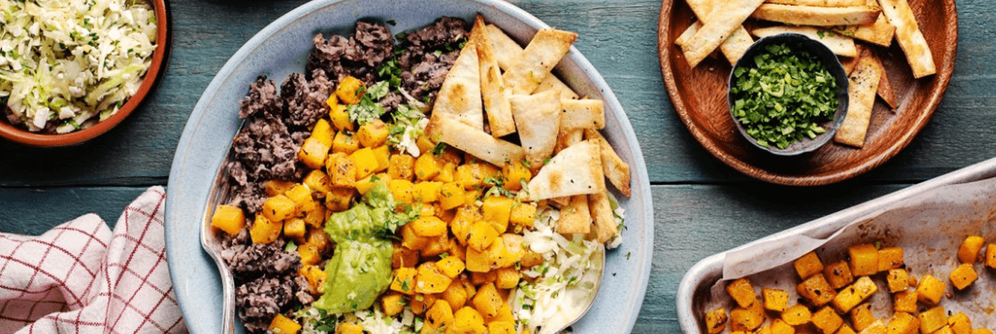 Roasted Squash Burrito Bowls with Refried Beans and Tortilla Strips